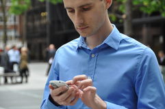 Business man with a mobile phone. Business man touching the mobile phone Royalty Free Stock Images