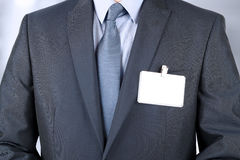 Business man in a modern suit with  a  Blank Badge. The business man in a modern suit with  a  Blank Badge Royalty Free Stock Images