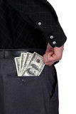 Business man and money. Business man reaching for some american dollars in his back pocket, close up Stock Images
