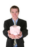 Business Man with Money (Focus on Piggy Bank) Royalty Free Stock Images