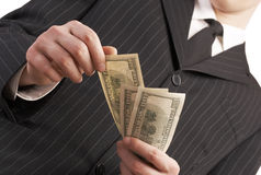 Business man with money in his hand. Counting and paying with american dollars Stock Image