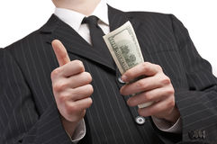 Business man with money in his hand. Counting and paying with american dollars Stock Photography