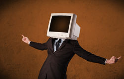 Business man with a monitor on his head and brown empty space Royalty Free Stock Photo