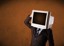 Business man with a monitor on his head and brown empty space Stock Images