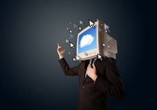 Business man with a monitor on his head, cloud system and pointe Royalty Free Stock Image