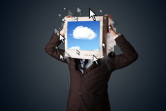 Business man with a monitor on his head, cloud system and pointe Stock Photo