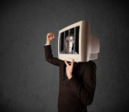 Business man with monitor on his head traped into a digital syst Royalty Free Stock Photos