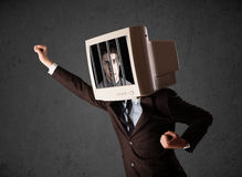 Business man with monitor on his head traped into a digital syst Royalty Free Stock Photo