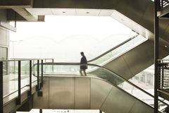 Business man moving. It is a business man move on escalator Stock Photo