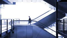 Business man moving. On escalator Royalty Free Stock Photos