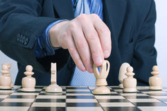 Business man moving chess figure Royalty Free Stock Photo