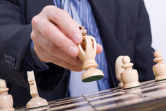 Business man moving chess figure Royalty Free Stock Photography