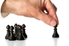 Business man moving chess figure in front of other chess figures. Management, leadership, teamlead or strategy concept over white background Stock Images