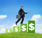 Business Man Moving Up Financially. Businessman moving up financial steps royalty free stock image