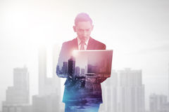 Business man with multiple exposure holding tablet computer. Business technology concept Stock Photography