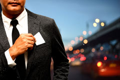 Business man with name card composite with city light background. S Stock Image