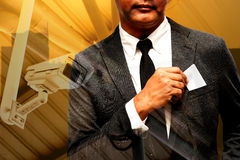 Business man with name card composite with city light background. Business man with name card composite with city lights background double exposure with cctv Royalty Free Stock Image