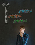 Business man Nascar racing car fan hand on chin on blackboard background Stock Photography