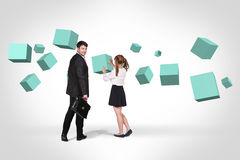 Business man near with turquoise cubes royalty free stock photo