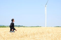 Business man near wind farm Royalty Free Stock Photo