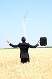 Business man near wind farm Royalty Free Stock Images