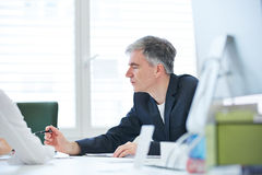 Business man negotiating in meeting Royalty Free Stock Photos