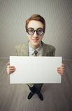 Business man nerd holds a blank sign Royalty Free Stock Photography