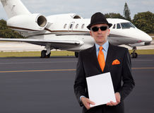 Business man next to a private jet Stock Photos