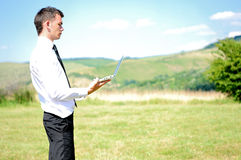 Business Man with notebook Stock Image