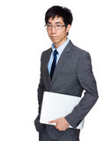 Business man with notebook computer Stock Image