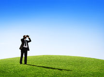 Business Man Observing Nature With a Telescope Stock Images