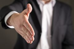 Business man offer and give hand for handshake. Royalty Free Stock Photo