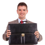 Business man offering briefcase Stock Image