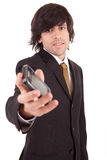 Business man offering cellphone Royalty Free Stock Image