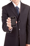 Business man offering cellphone Stock Images