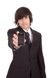 Business man offering cellphone Stock Photos