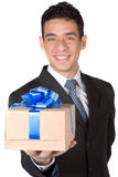 Business man offering a gift Stock Photography