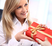 Business man offering a gift Royalty Free Stock Photo