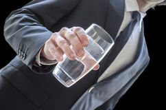 Business man offering a glass of water Stock Images