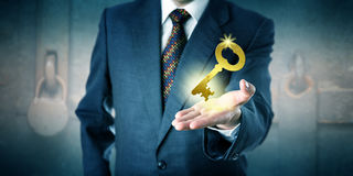 Business Man Offering A Golden Key In Open Palm stock photos