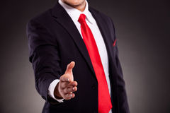 Business man offering hand shake Royalty Free Stock Images