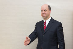 Business man offering a handshake Royalty Free Stock Image