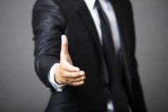 Business man offering handshake Royalty Free Stock Photos