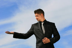 Business man offering an object. Holding an object in the palms of his hands Royalty Free Stock Photography