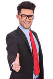 Business man offering to shake hands stock photos