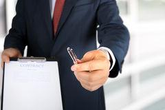 Business man is offering to sign  a contract, business contract details Stock Photos
