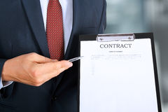 Business man is offering to sign  a contract, business contract details Stock Photography