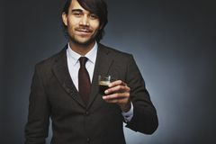 Business man offering you a cup of coffee Royalty Free Stock Image
