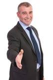 Business man offers handshake Royalty Free Stock Photo