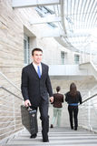 Business Man at Office. An attractive  business man walking up stairs at office building Royalty Free Stock Photo